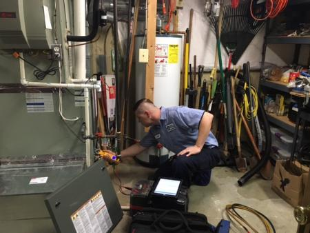 technician servicing heater